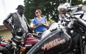 Steven J. Chalmers, also known as Bootleg, chats with Keena Roberts about her new bike at the VFW Rider's Thursday Night Thunder event at VFW Post 1865 in Kenosha.